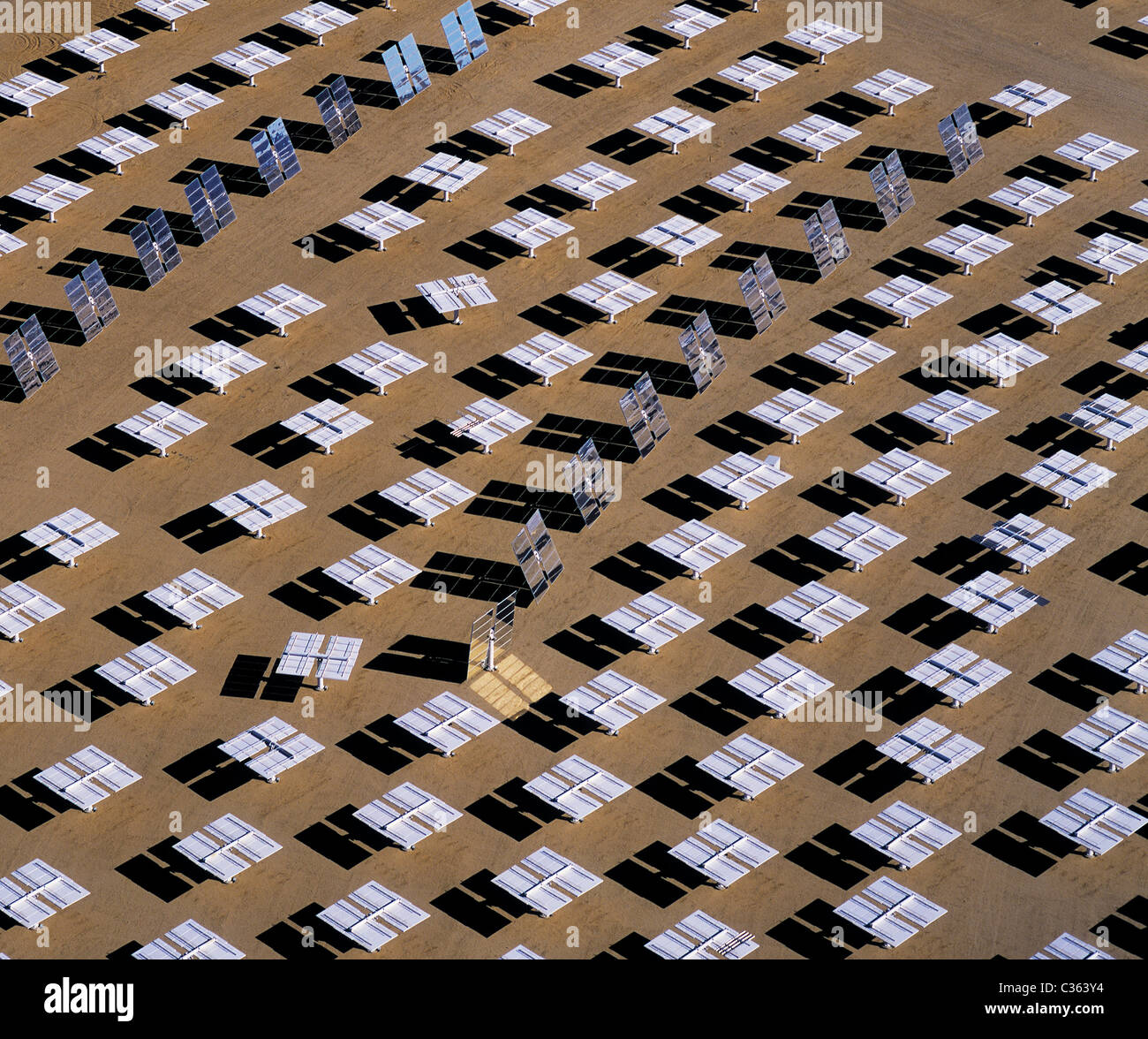 aerial view above Solar Two electrical energy generation project mirrored heliostats Daggett California - Stock Image