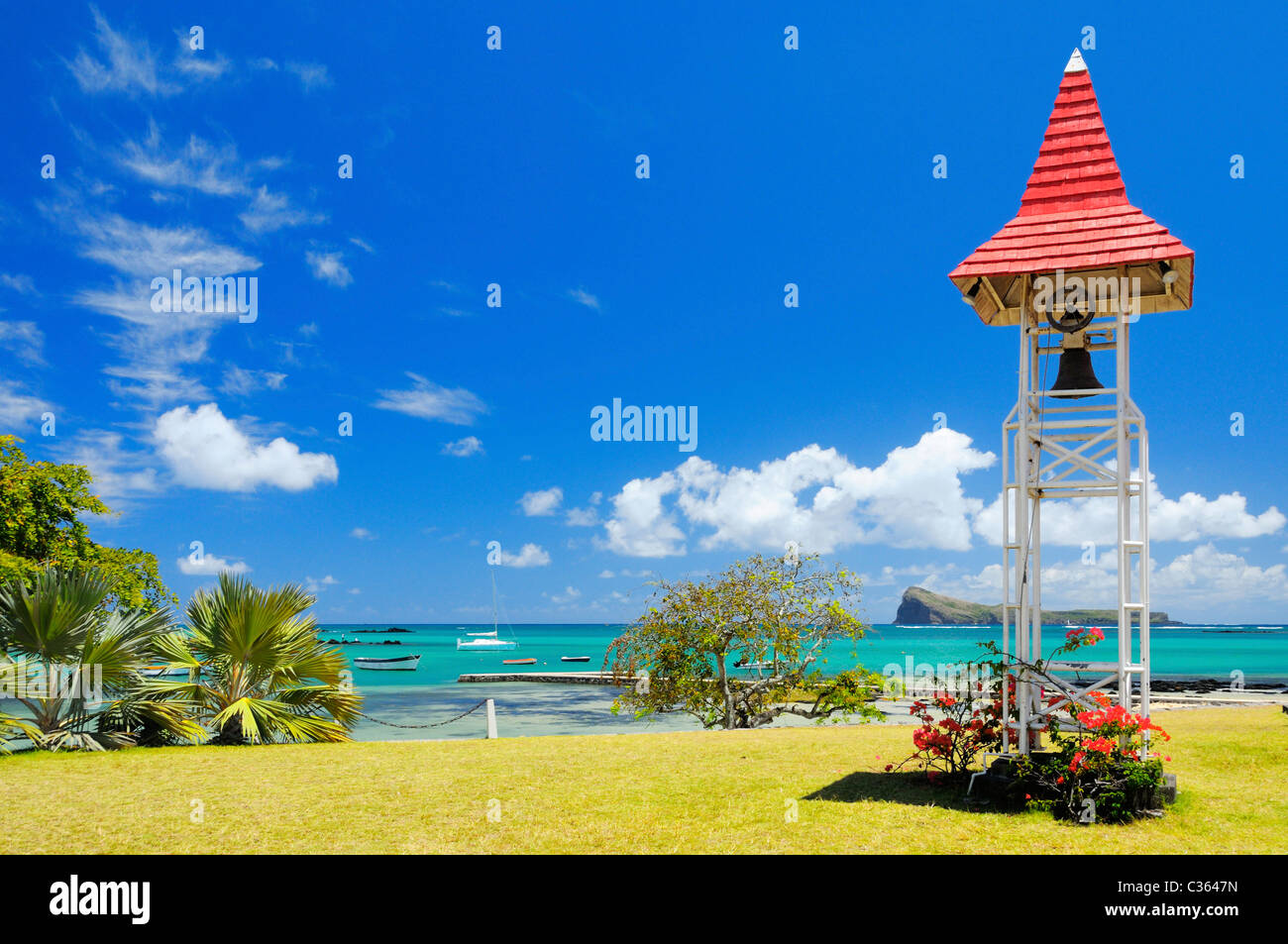 The garden of the famous landmark church with a red roof in Cap Malheureux, Riviere du Rempart, Mauritius. - Stock Image