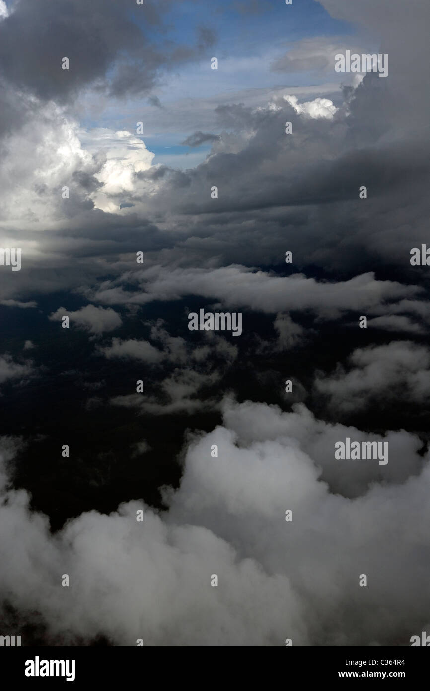 aerial photography above cumulus clouds between layers - Stock Image