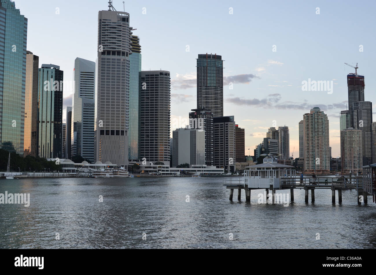 Brisbane City late in the afternoon. The Brisbane River is in the foreground. - Stock Image
