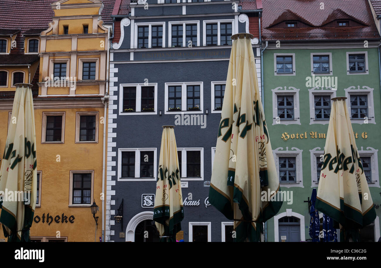Shop fronts and umbrellas. - Stock Image