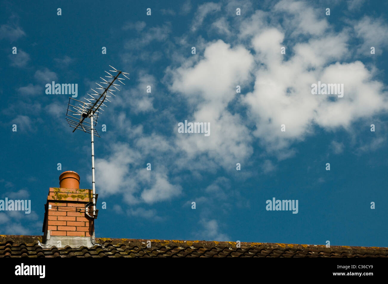 A UK television aerial on top of a house - Stock Image