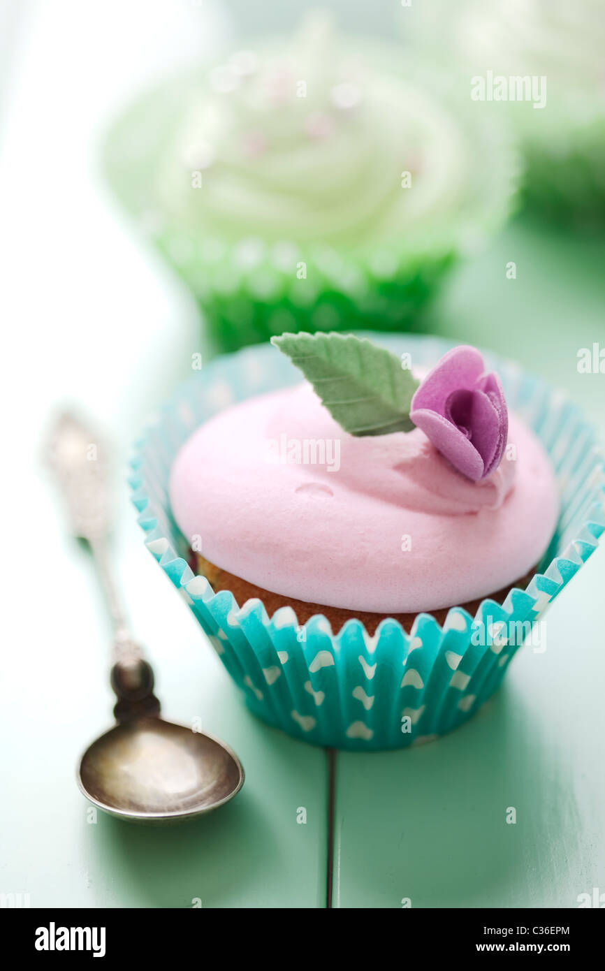 closeup of beautiful summer cupcake with strawberry flavoured cream - Stock Image
