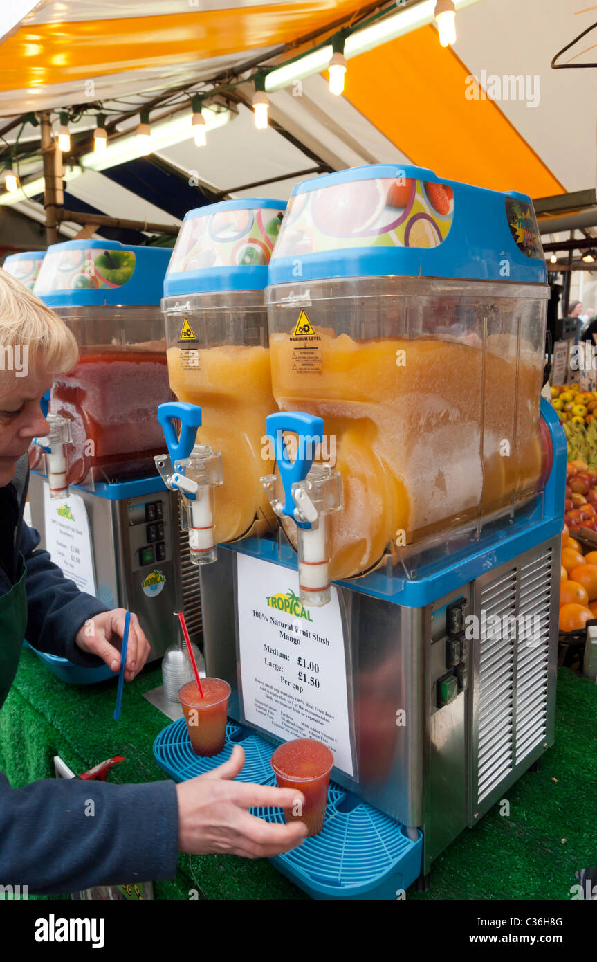 Fresh Tropical 100% natural fruit slush for sale on a market stall in Cambridge , Cambridgeshire , England , Britain - Stock Image