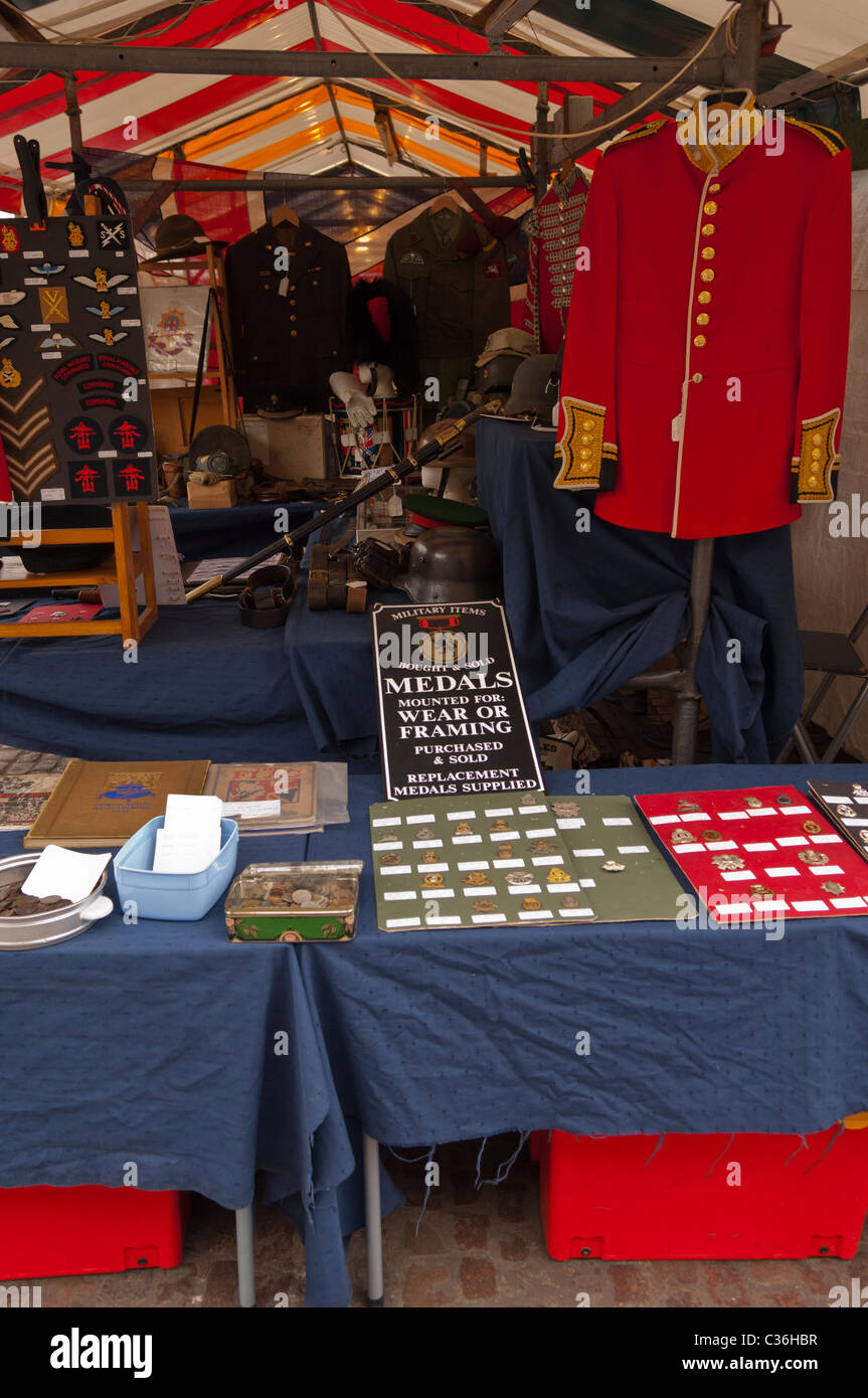 Medals and military items for sale on a market stall in Cambridge , Cambridgeshire , England , Britain , Uk - Stock Image
