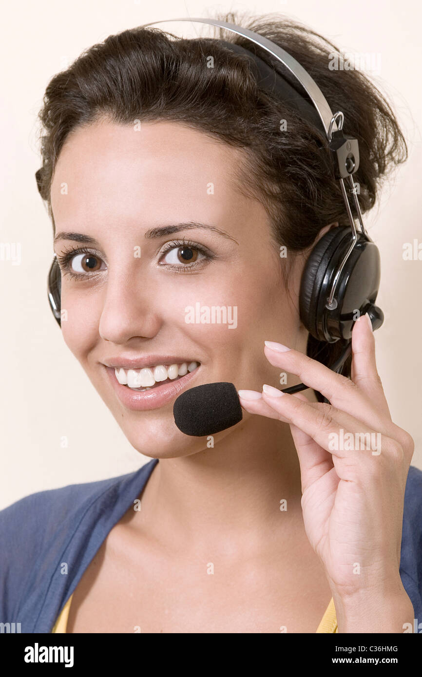 business customer support operator woman smiling, helpline operator Stock Photo