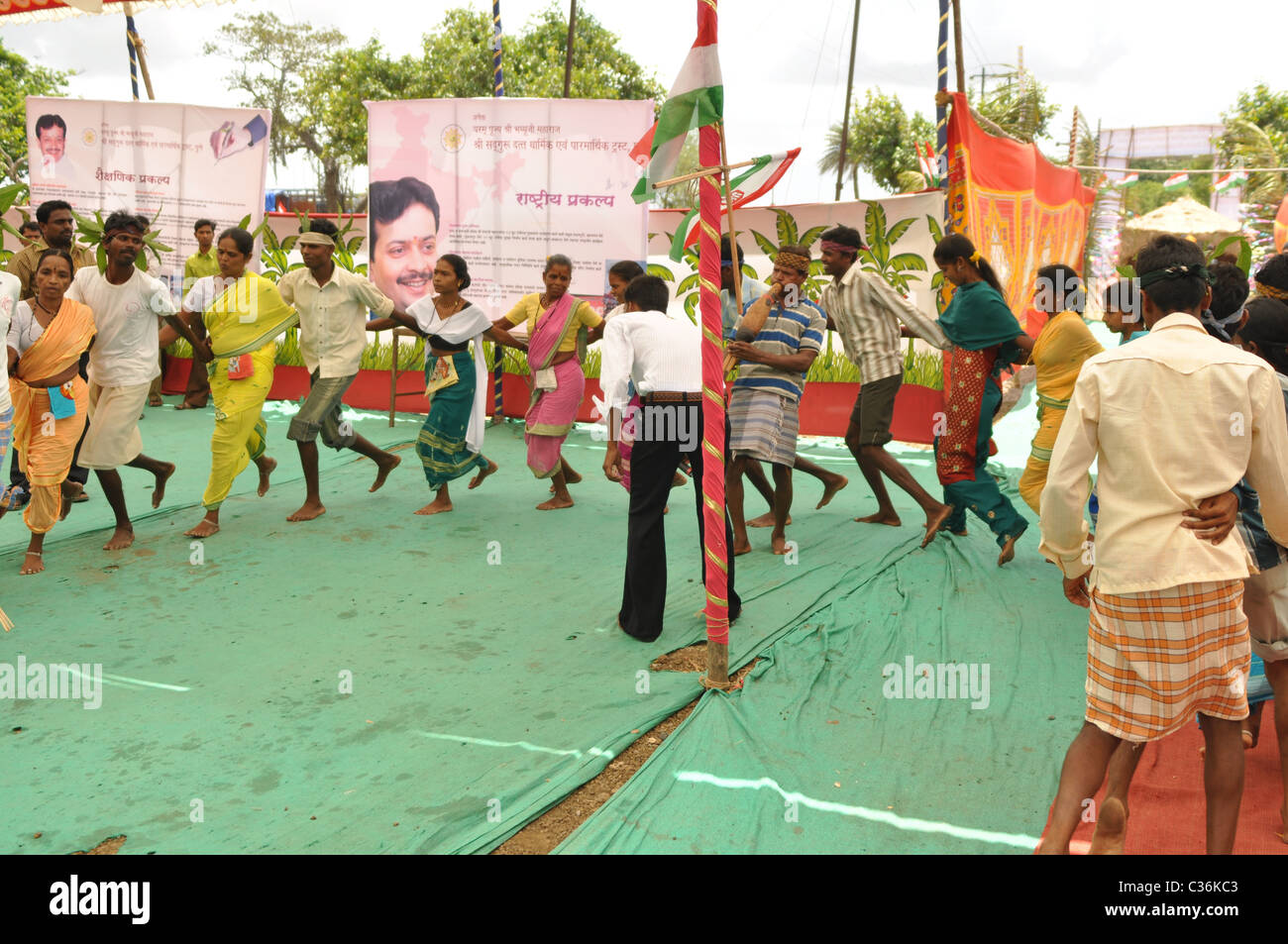 A group of Local Marathi Dancers Dancing at a Mass Marriage Ceremony. - Stock Image