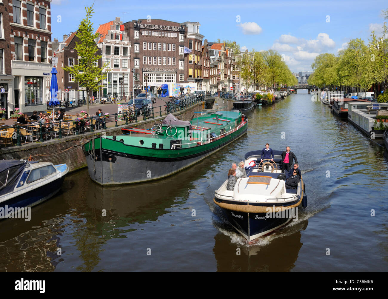 Amsterdam, Netherlands. Boats on Prinsengracht canal - Stock Image