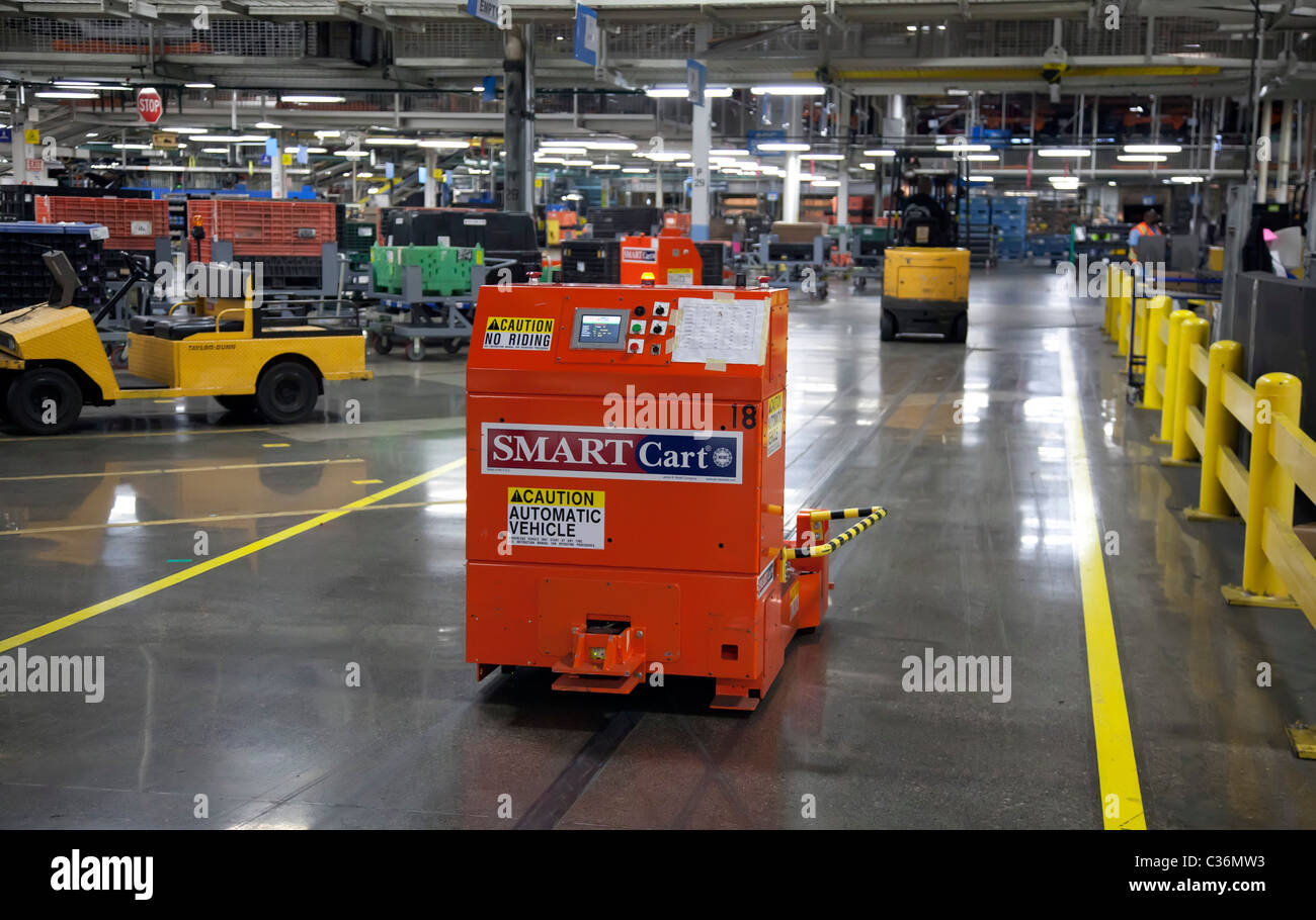 Detroit, Michigan - An automated, driverless cart delivers parts around Chrysler's Jefferson North Assembly - Stock Image