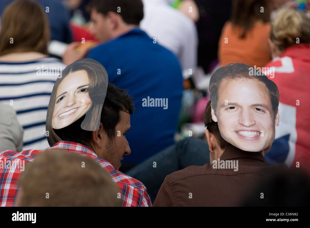 royal wedding, revellers wearing katie middleton and Prince william masks hyde park - Stock Image