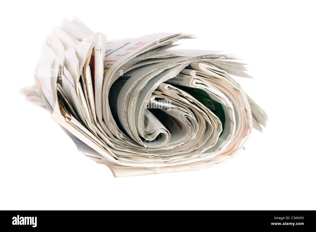 Roll of newspapers, isolated on white background - Stock Image
