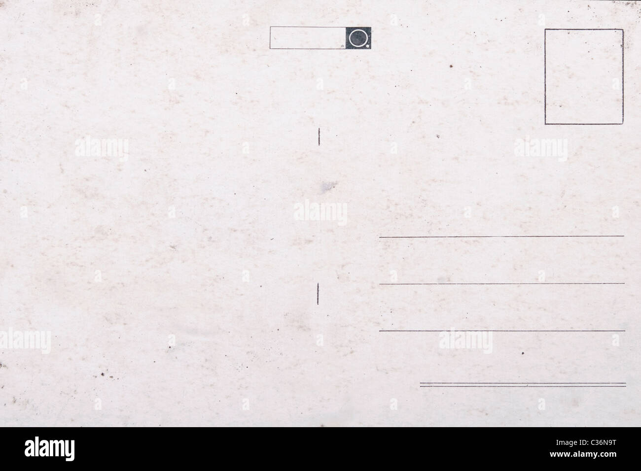 Old empty postcard, grunge paper with aging marks - Stock Image