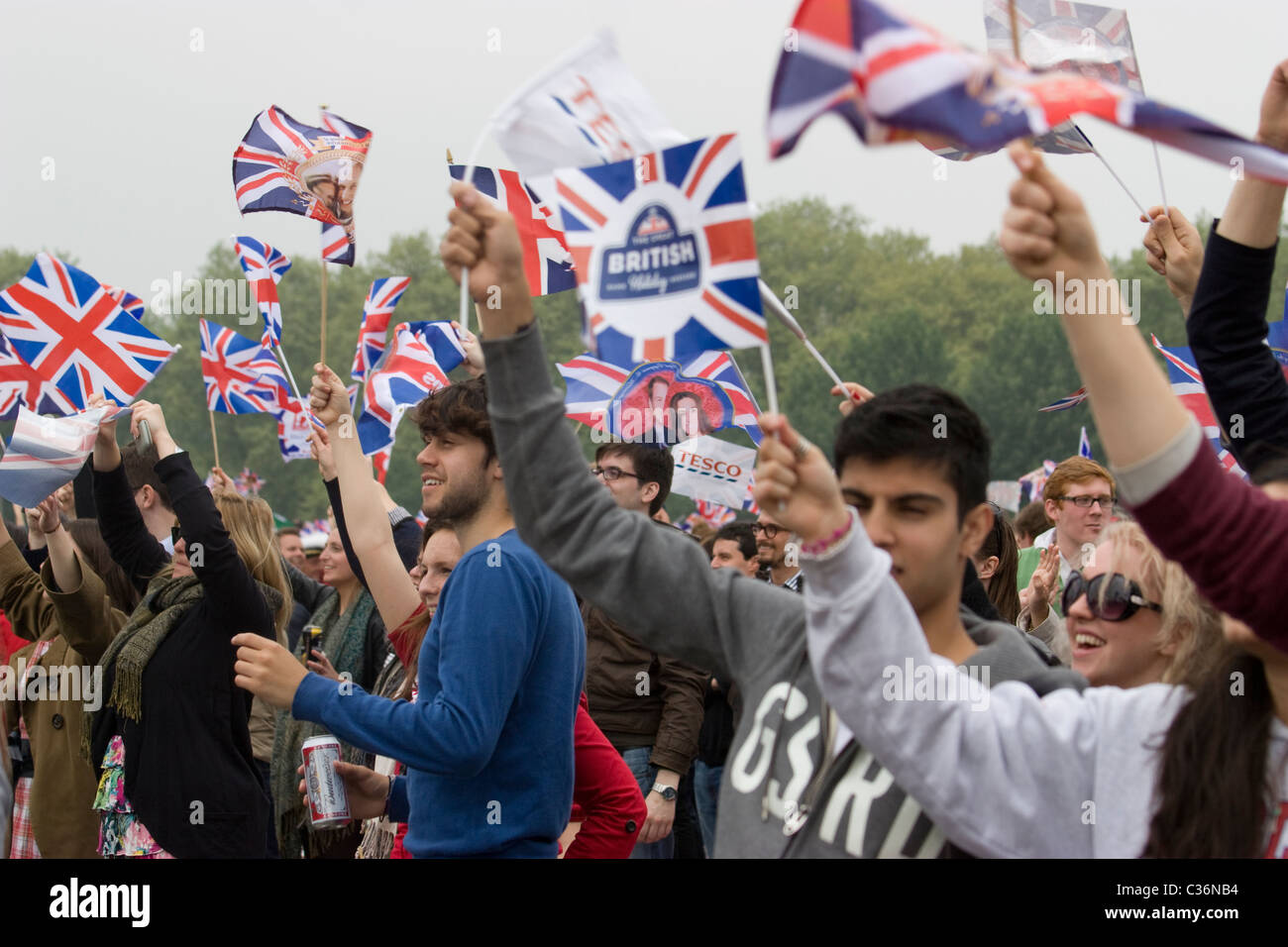 royal wedding hyde park reveller with union jack flags - Stock Image