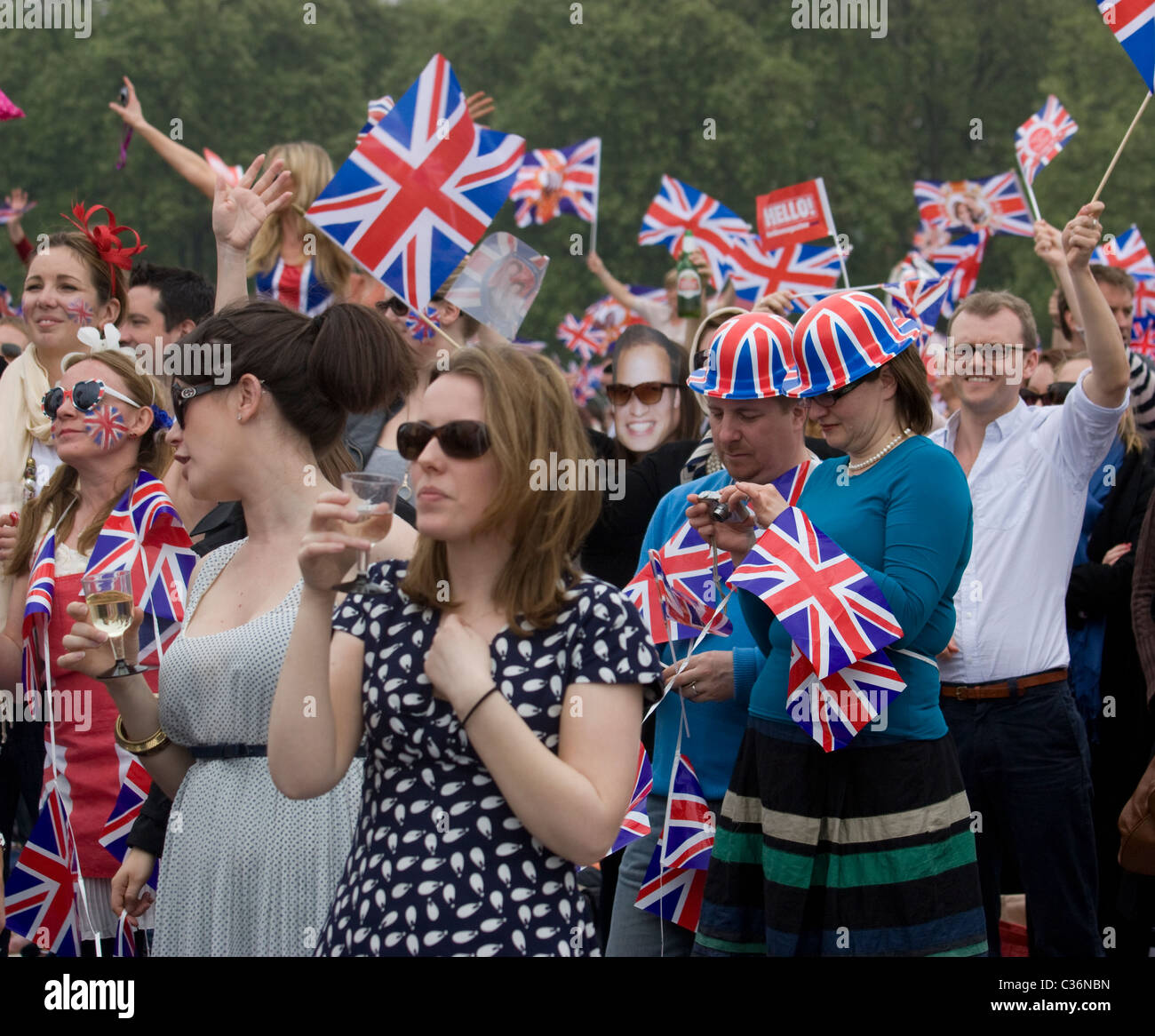 royal wedding hyde park reveller with union jack flags and hat - Stock Image