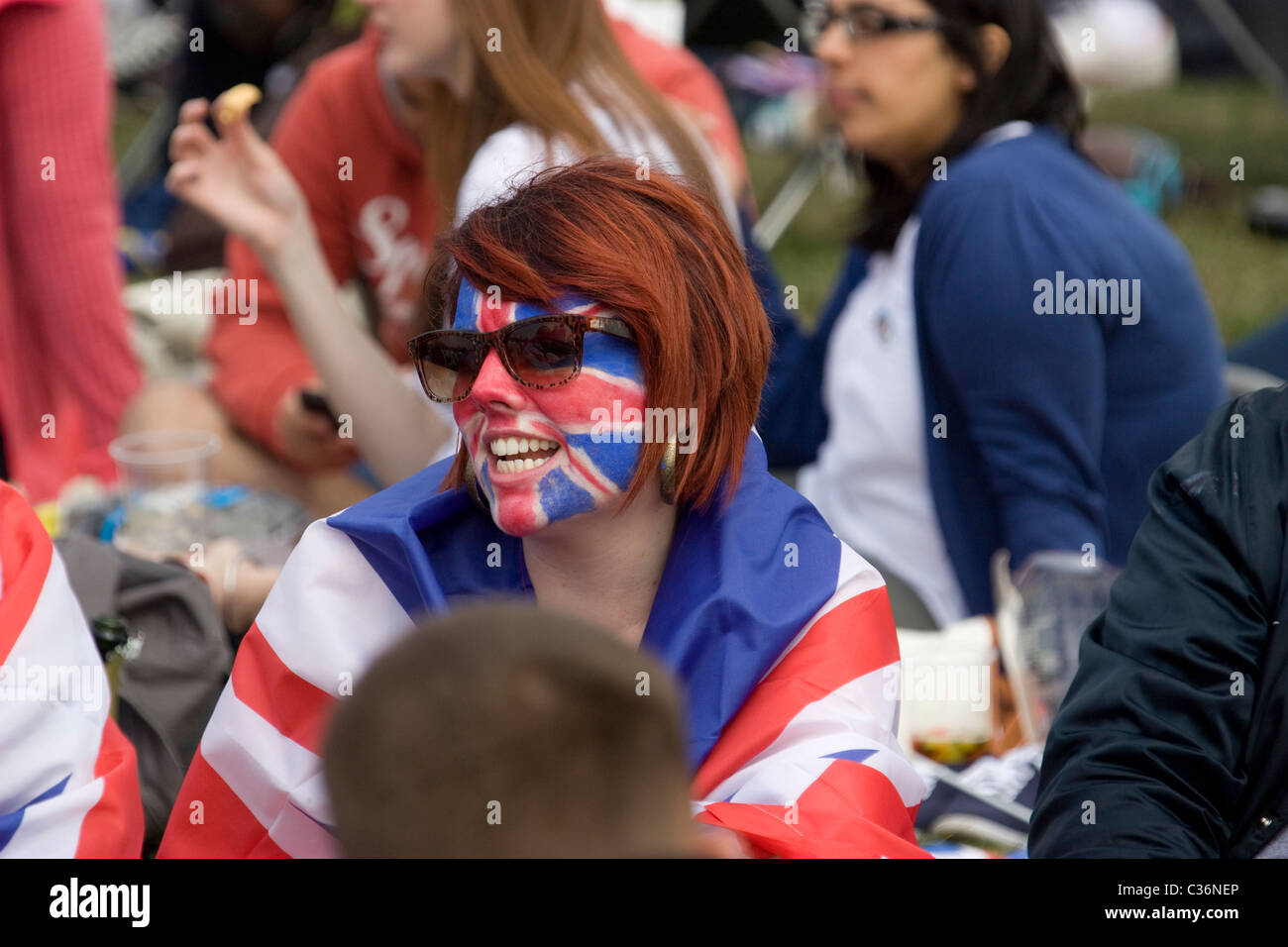 royal wedding reveller with union jack face paints draped in union jack flag hyde park - Stock Image