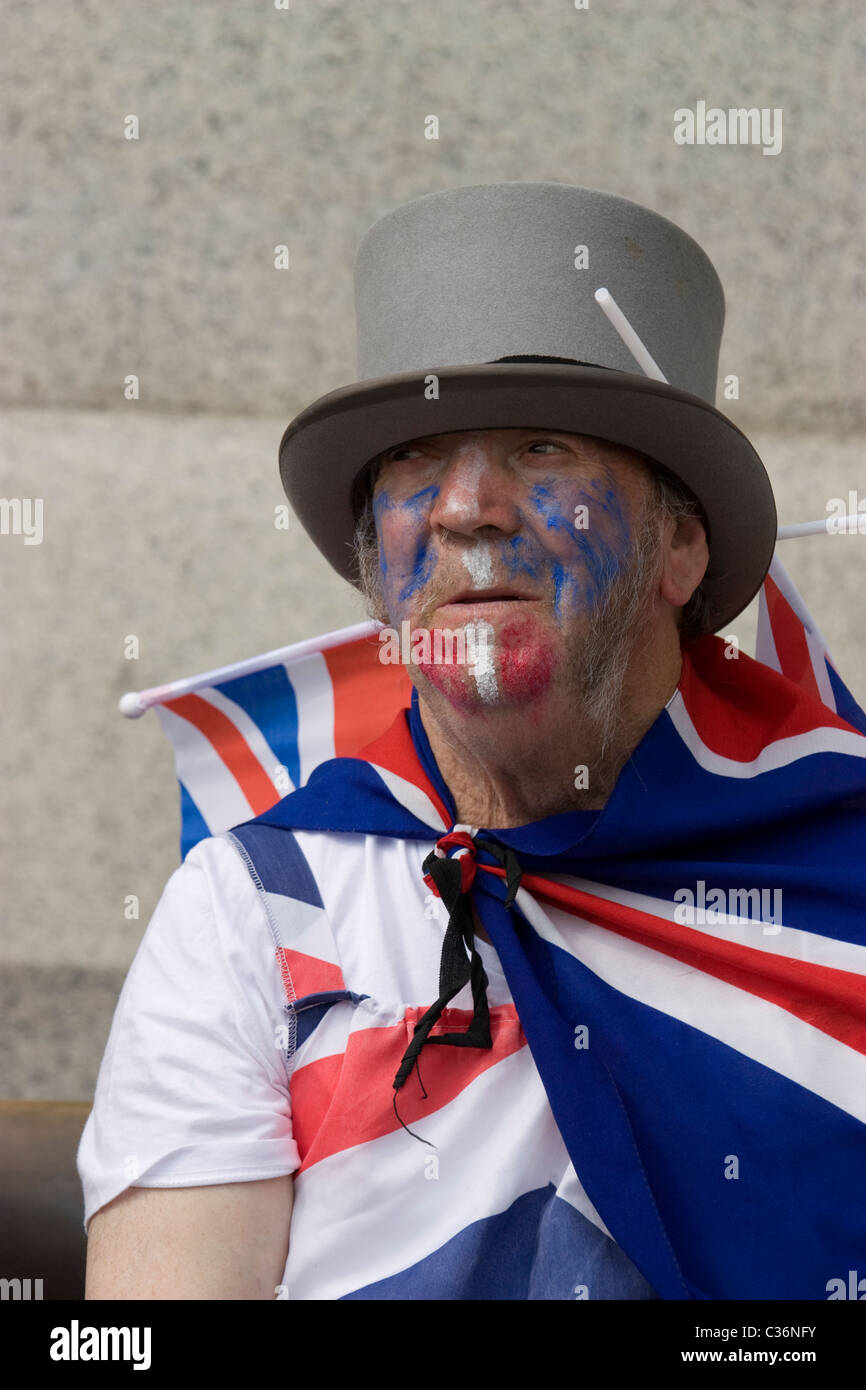 royal wedding reveller with top hat and face paints Trafalgar square London - Stock Image