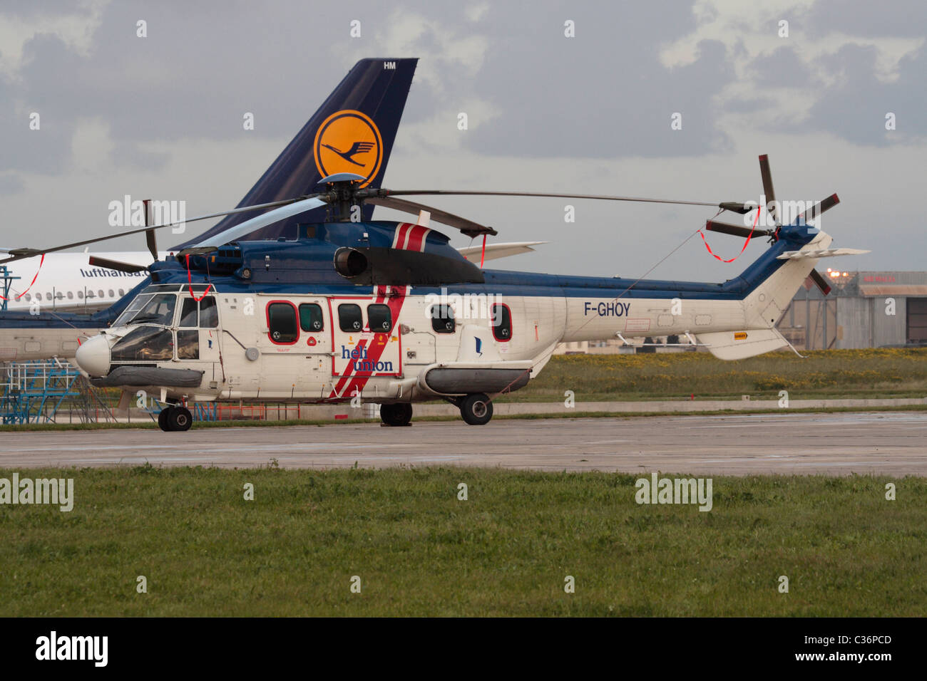 Heli-Union Super Puma helicopter parked on the ground - Stock Image