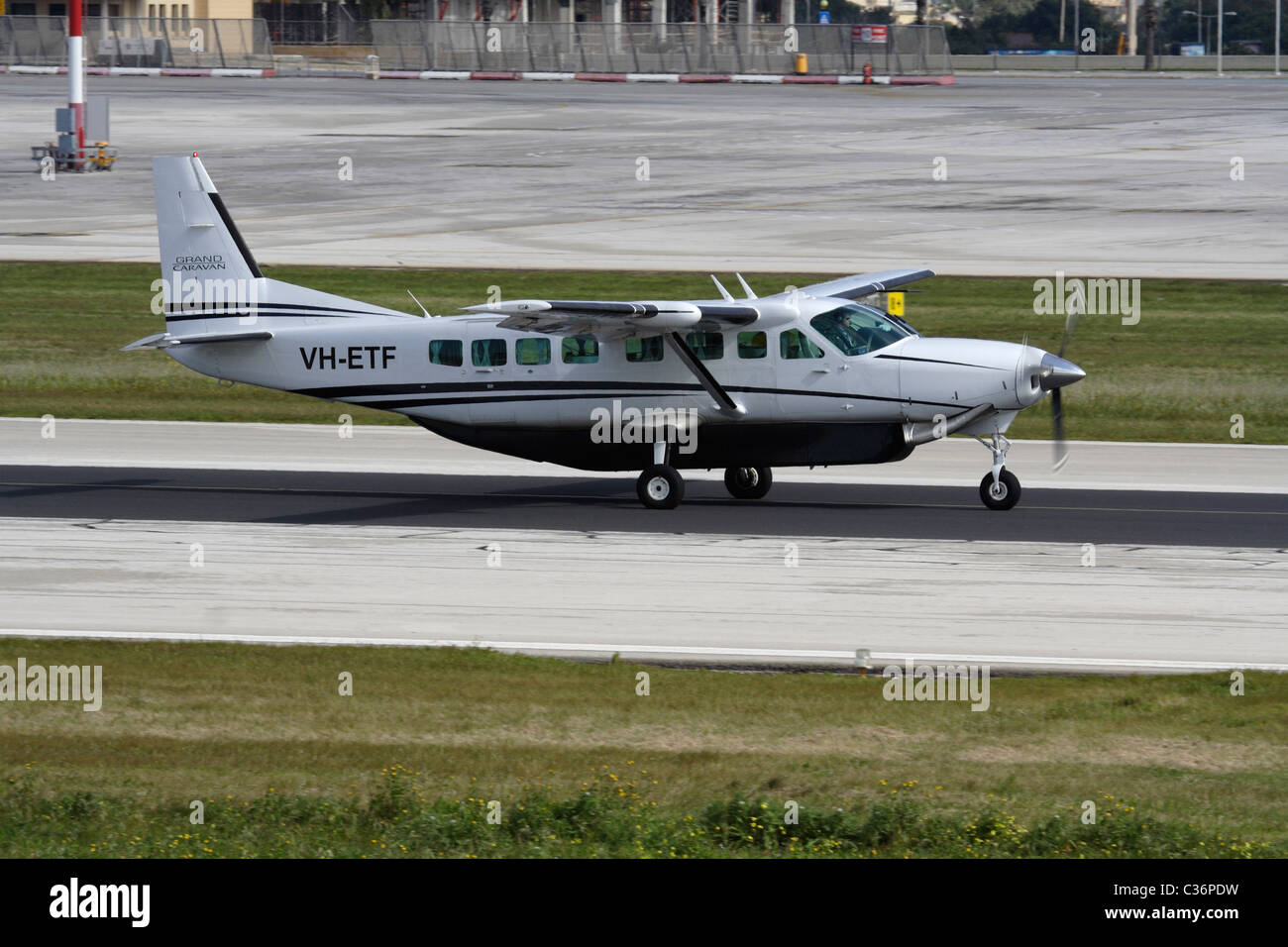 Cessna 208B Grand Caravan single-engine turboprop commuter aircraft taxiing on the runway before departure from - Stock Image
