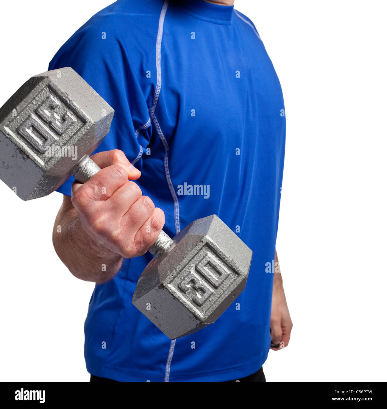 man exercising with 30 pound dumbbell - Stock Image