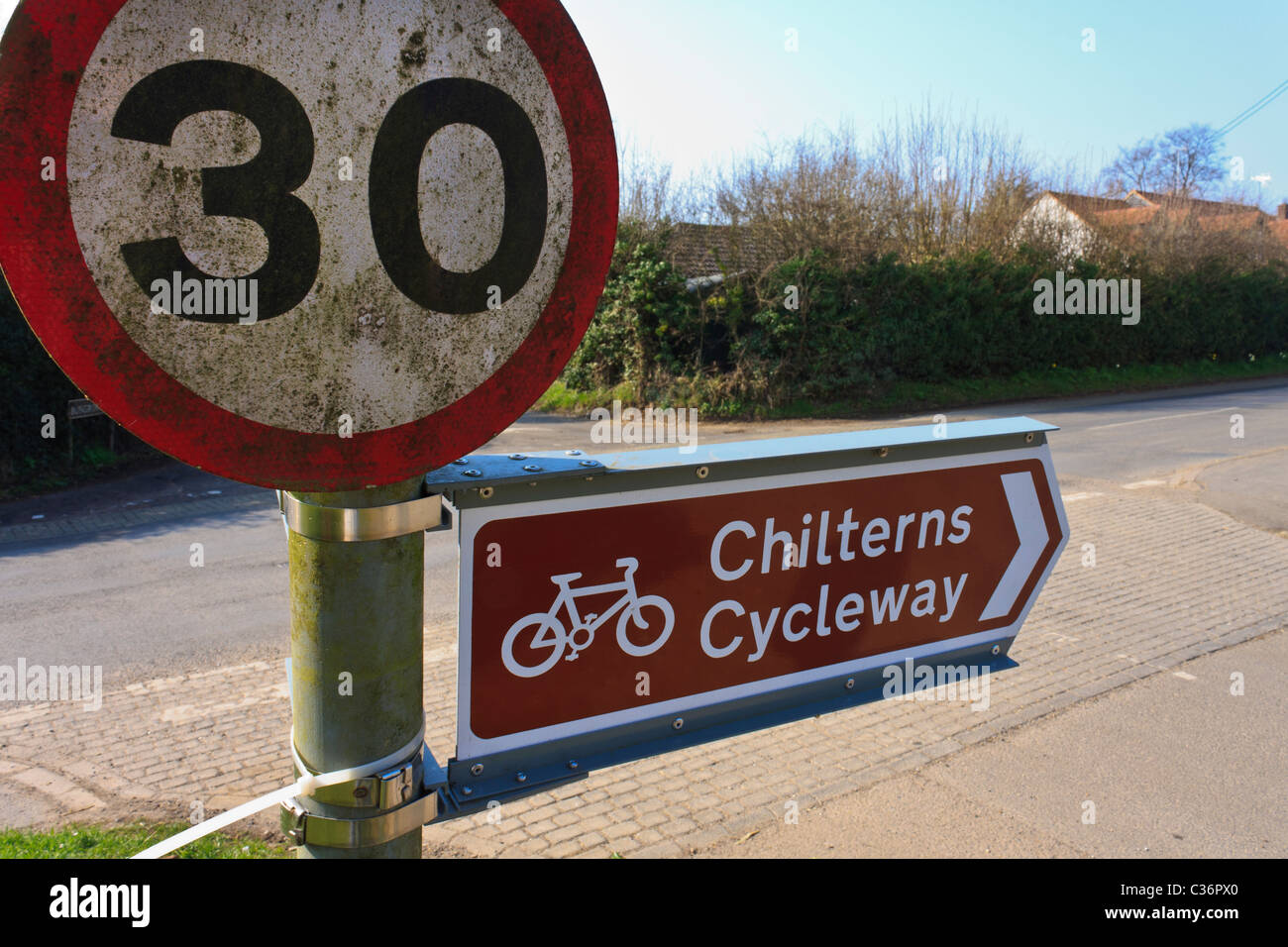 Chilterns Cycleway sign and 30 mph speed limit sign. - Stock Image
