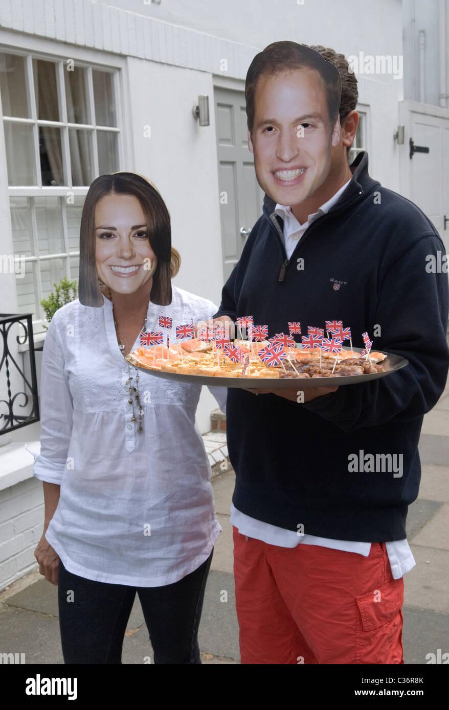 Royal Wedding Street Party. Chelsea London. Prince William and Princess Catherine  Kate Middleton souvenir masks. Stock Photo