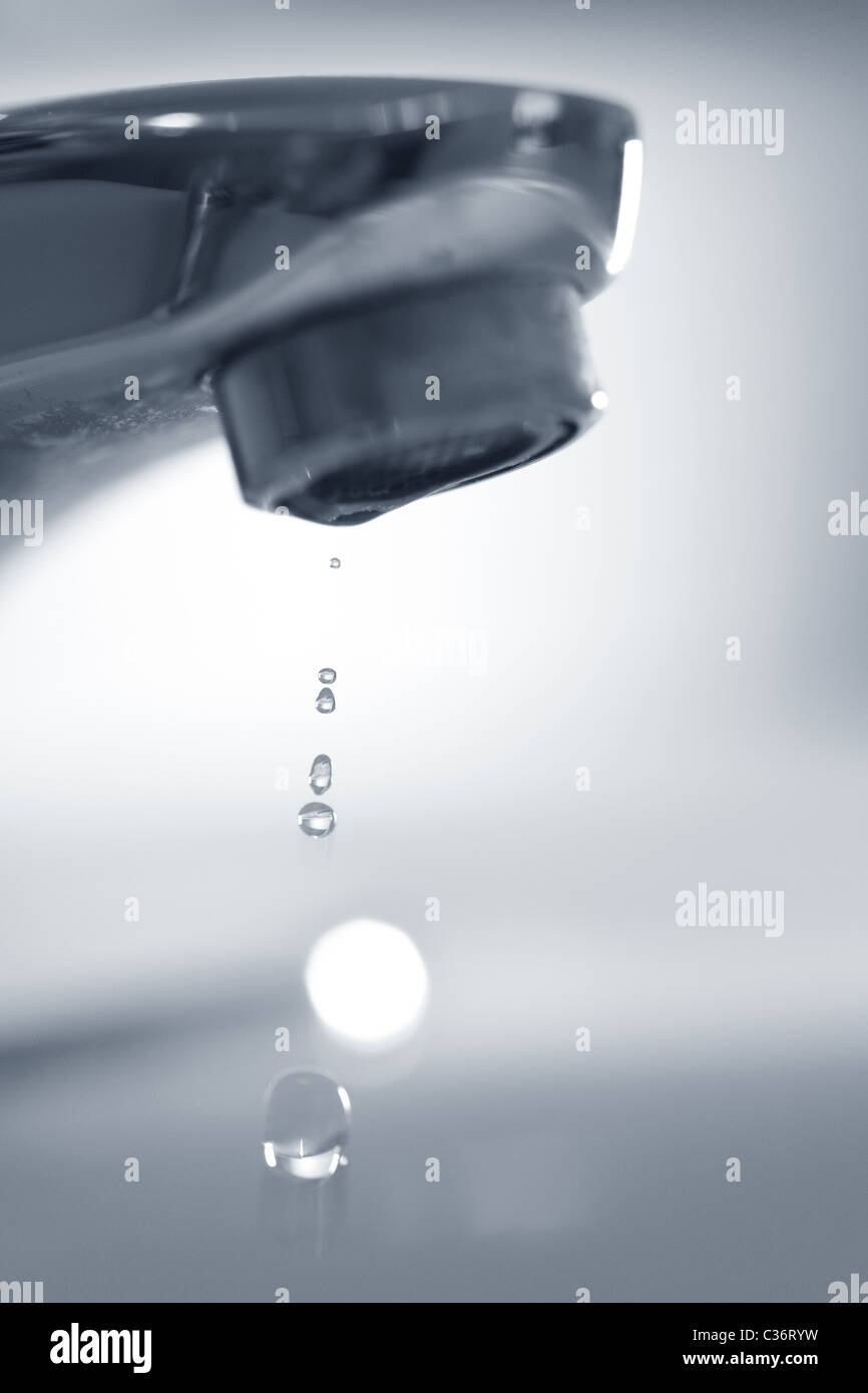 water Faucet /tap and Running Water close up shot - Stock Image