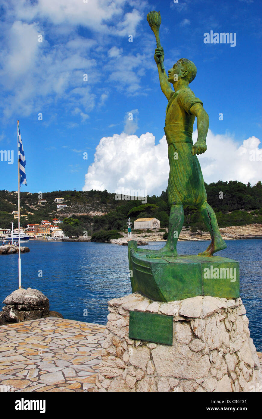The statue of Captain Georgios Anemogiannis guarding the harbour of Gaios on the Island of Paxos, Greece - Stock Image