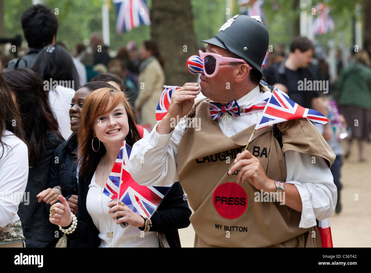 People in Hyde Park/The Mall celebrating the wedding day of Prince William and Kate Middleton in 2011 Stock Photo