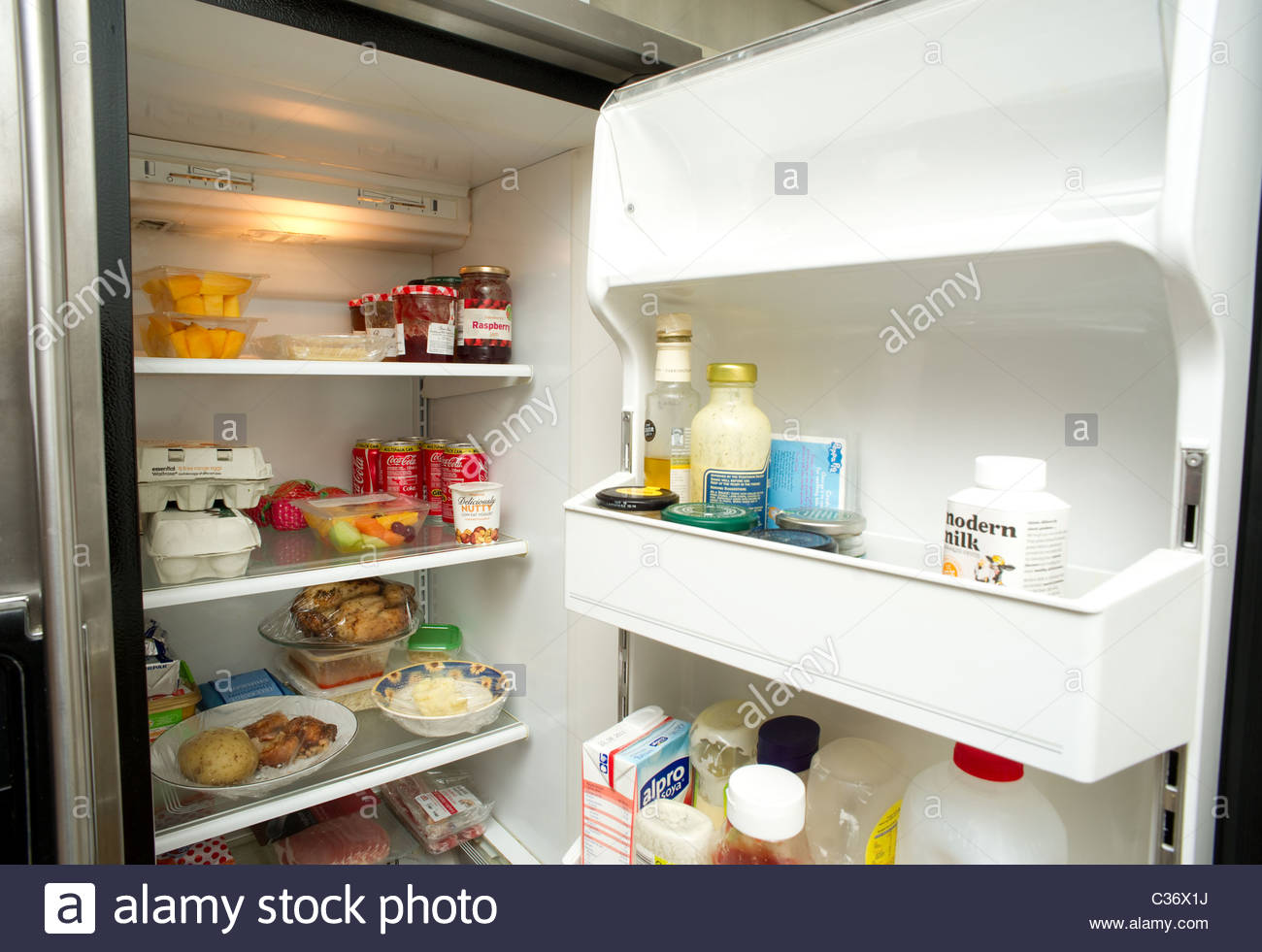 Modern kitchen fridge refrigerator - Stock Image