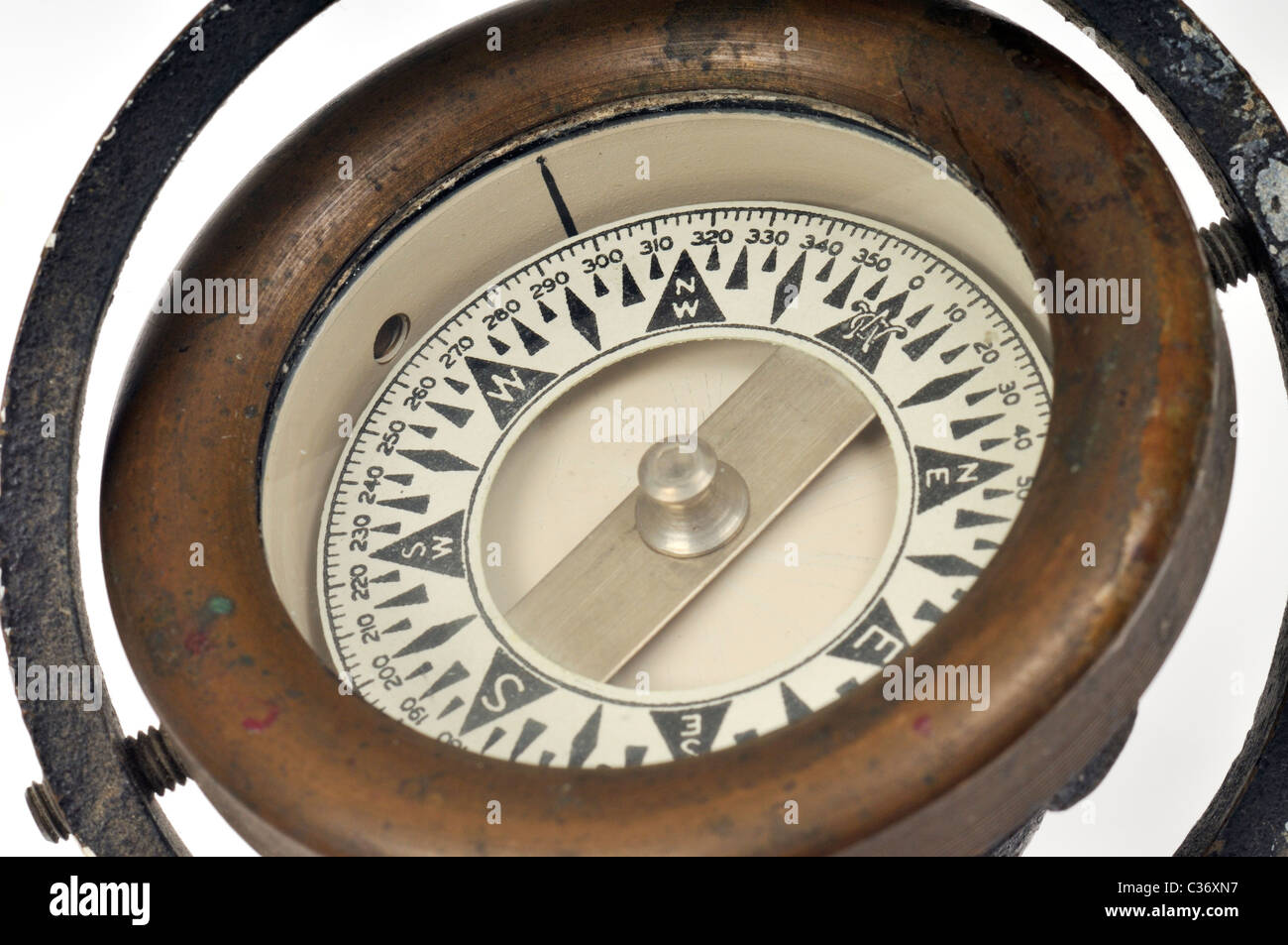 Close-up of face of an old brass navigation compass - Stock Image
