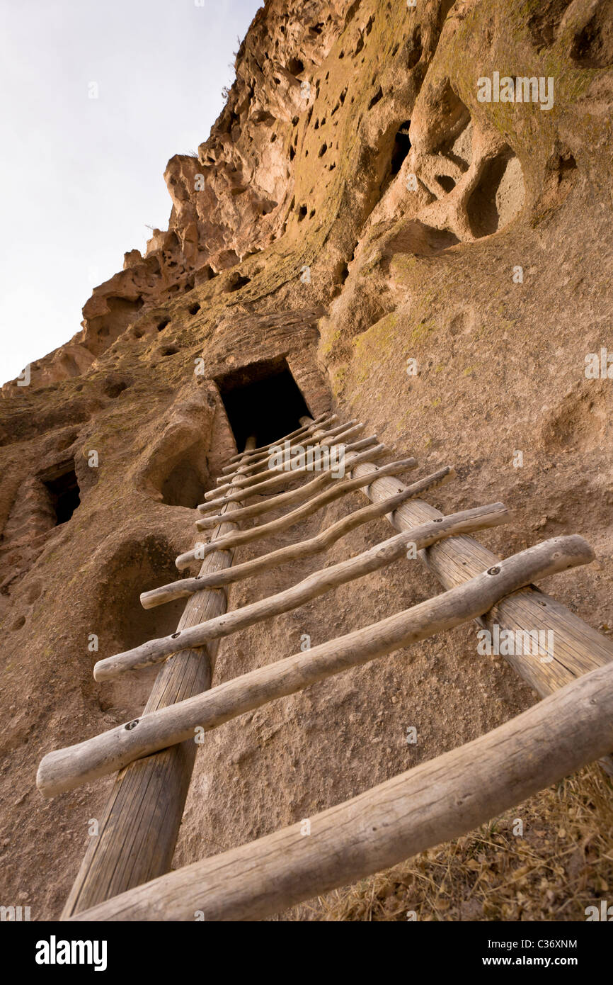 Wooden ladder leading to the Talus Houses, Native American cliff dwelling at Bandelier National Monument in New Stock Photo