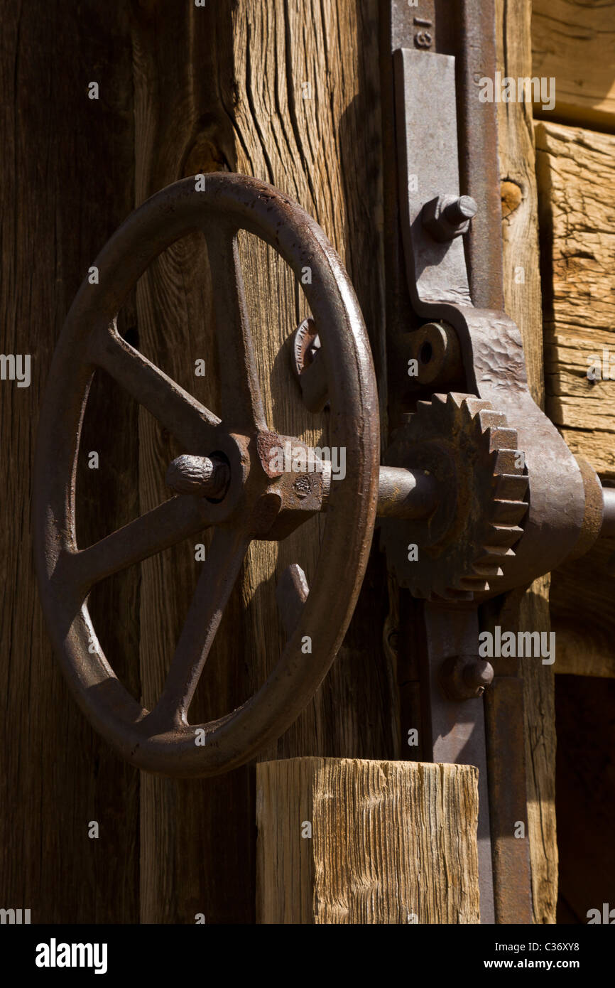 Taylor headframe wheel and gears at the Kelly Mine Ghost Town in Socorro County, New Mexico, USA. - Stock Image