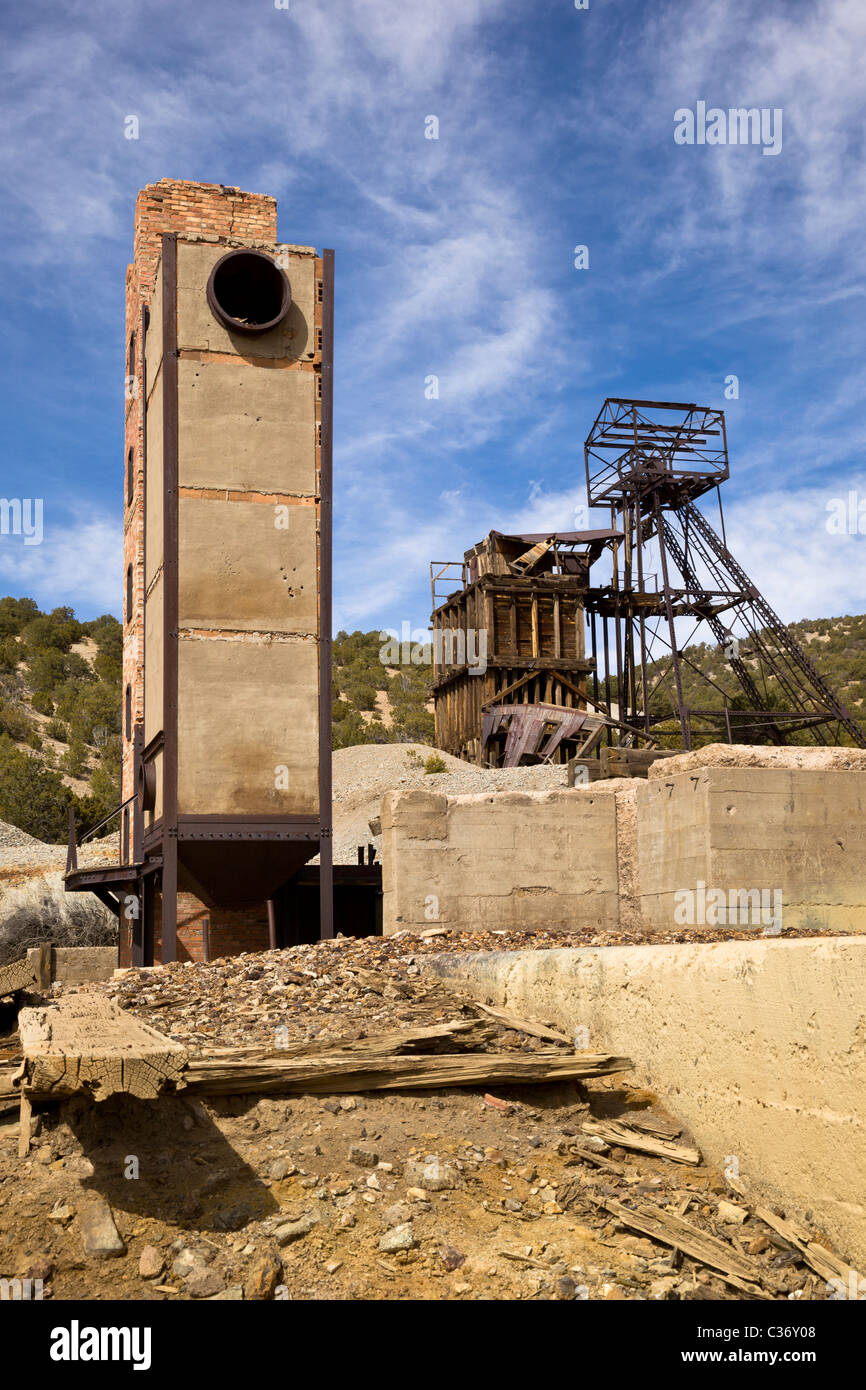 Towering smelter oven and the Taylor headframe and at the Kelly Mine Ghost Town in Socorro County, New Mexico, USA. - Stock Image
