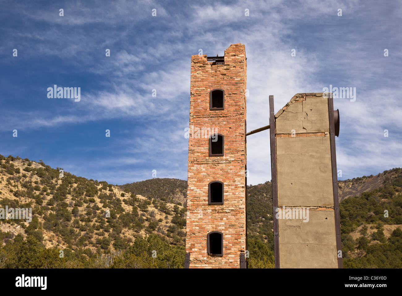 Towering smelter oven and the Magdalena Mountains at the Kelly Mine Ghost Town in Socorro County, New Mexico, USA. - Stock Image