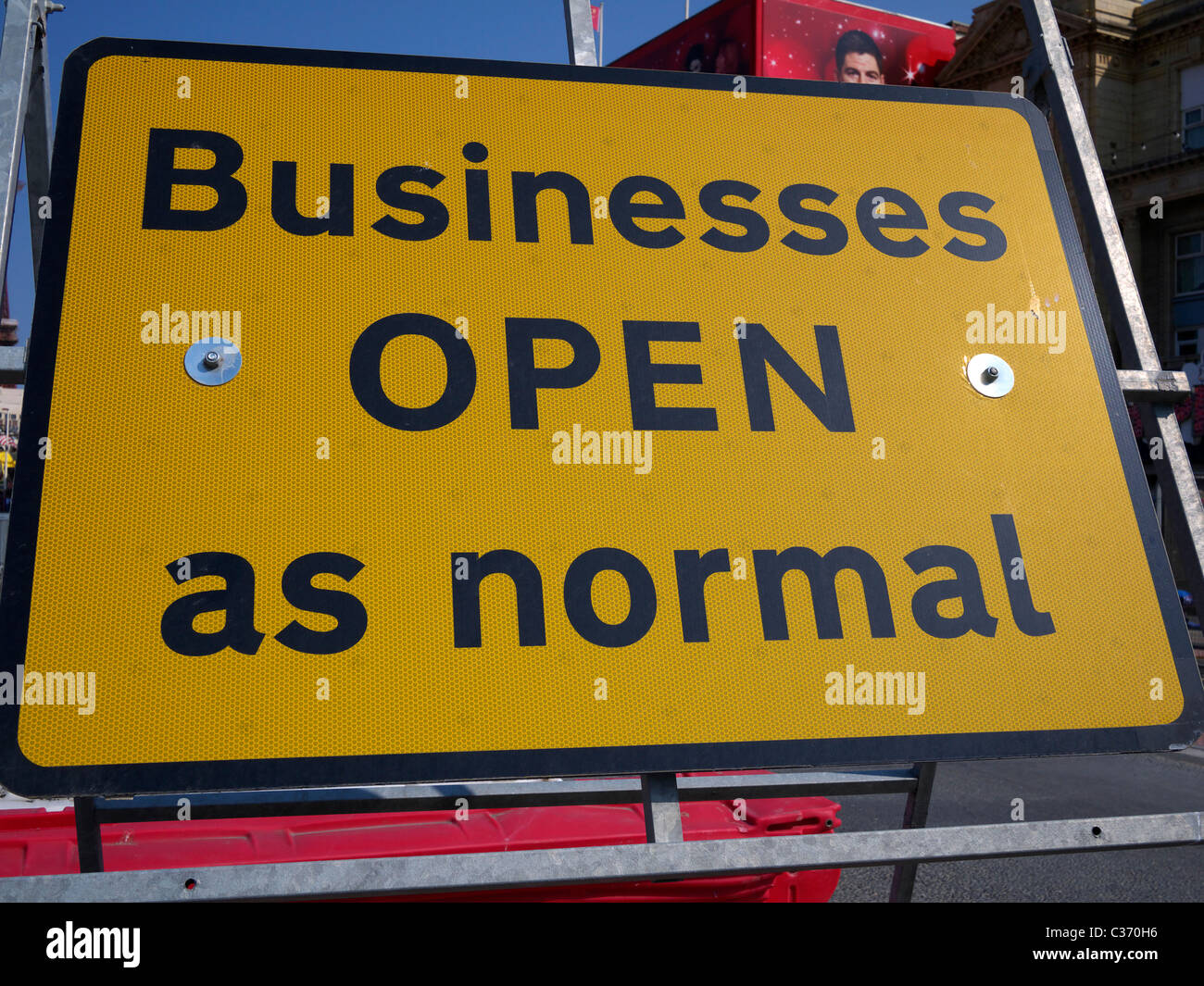 Businesses open as normal road sign along the promenade Blackpool Lancashire UK - Stock Image