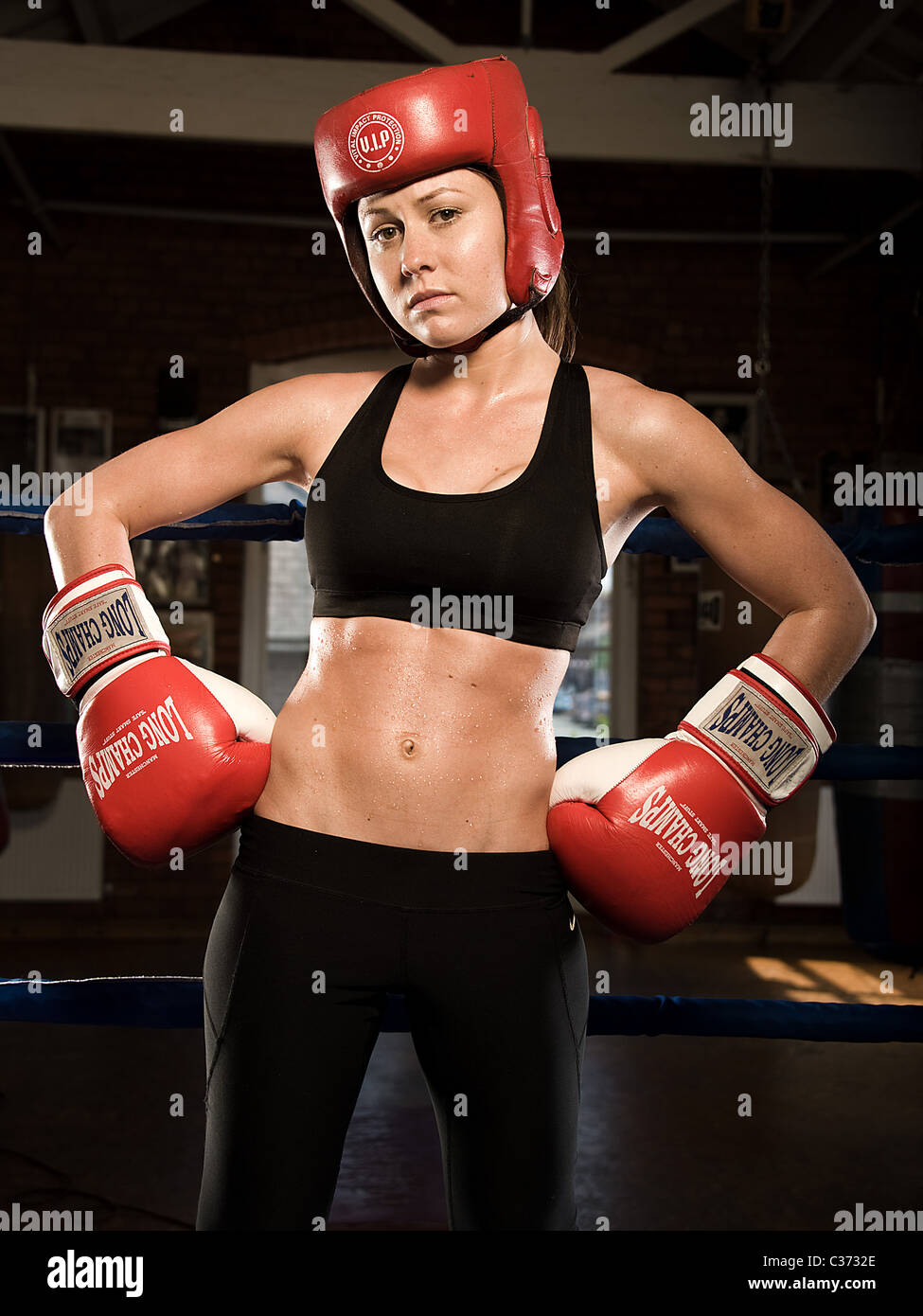 Portrait of female boxer before a fight - Stock Image
