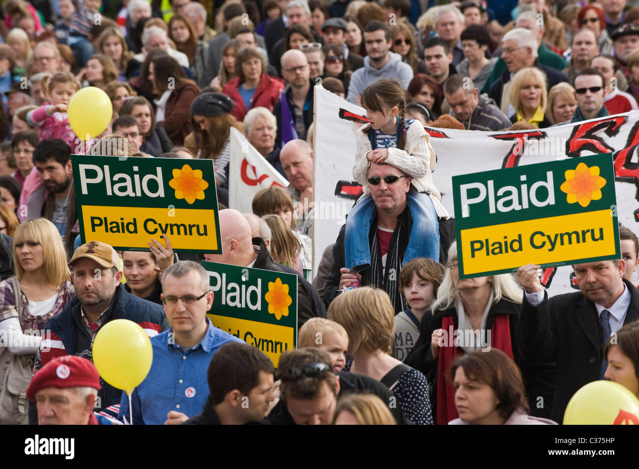 Protesters with placards and banners listen to speeches at S4C Rally outside WAG Offices in Cardiff South Wales - Stock Image
