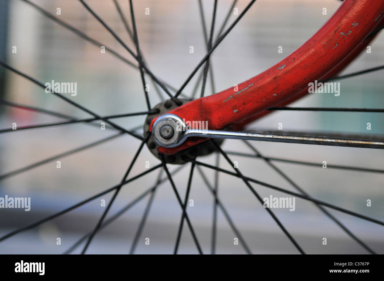 A bike felly with some spokes and the center fitting. - Stock Image