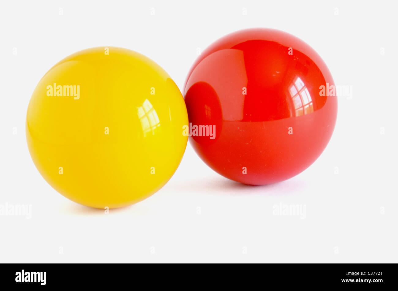 yellow and red cue bill on white background - Stock Image