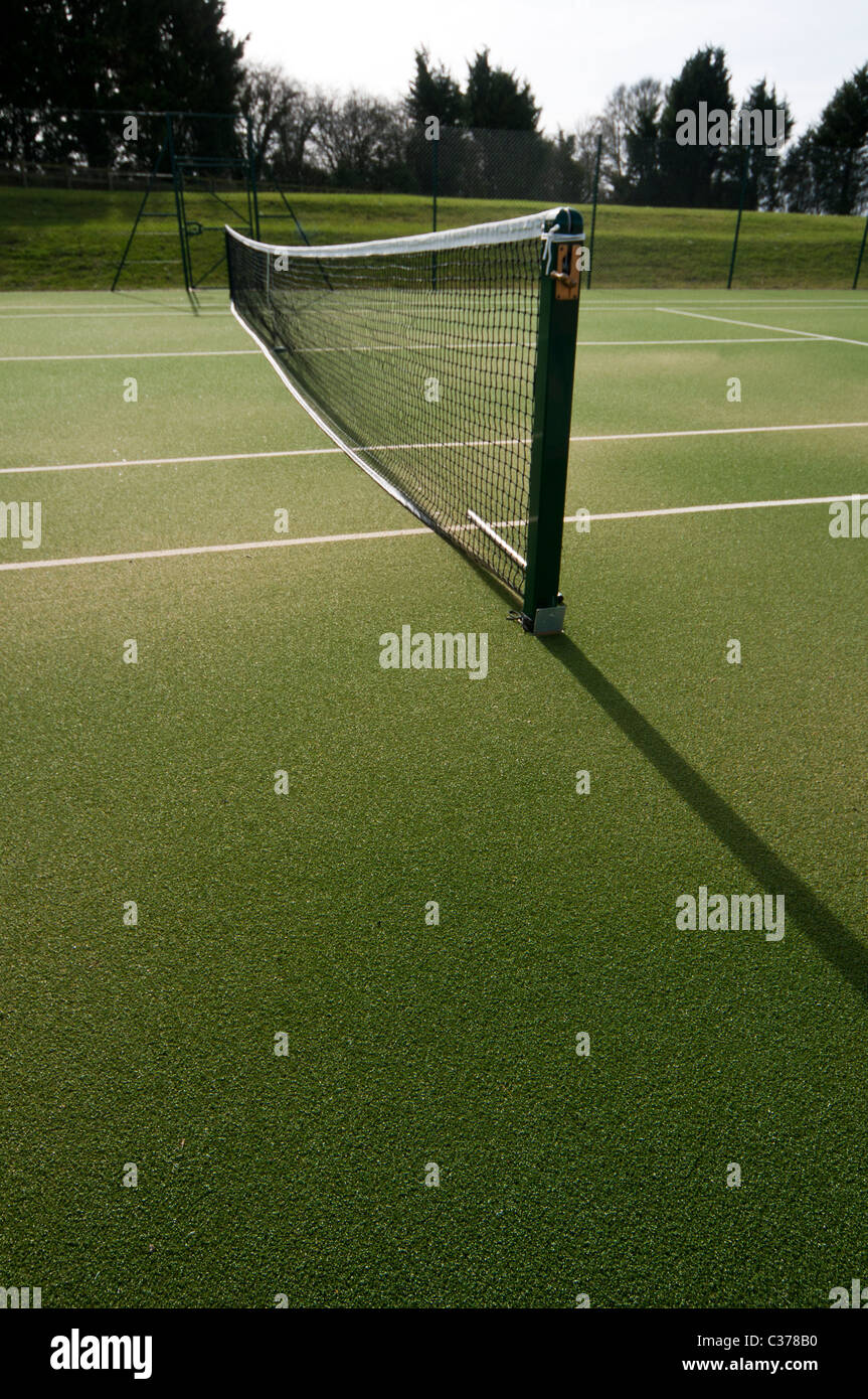 outdoor tennis courts with new nets and green astro turf await players - Stock Image