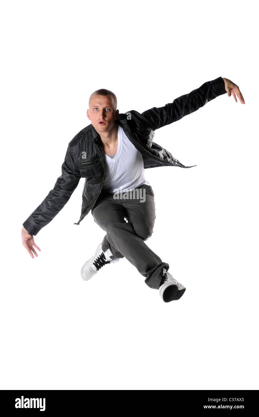 Young hip hop dancer jumping isolated over white background - Stock Image