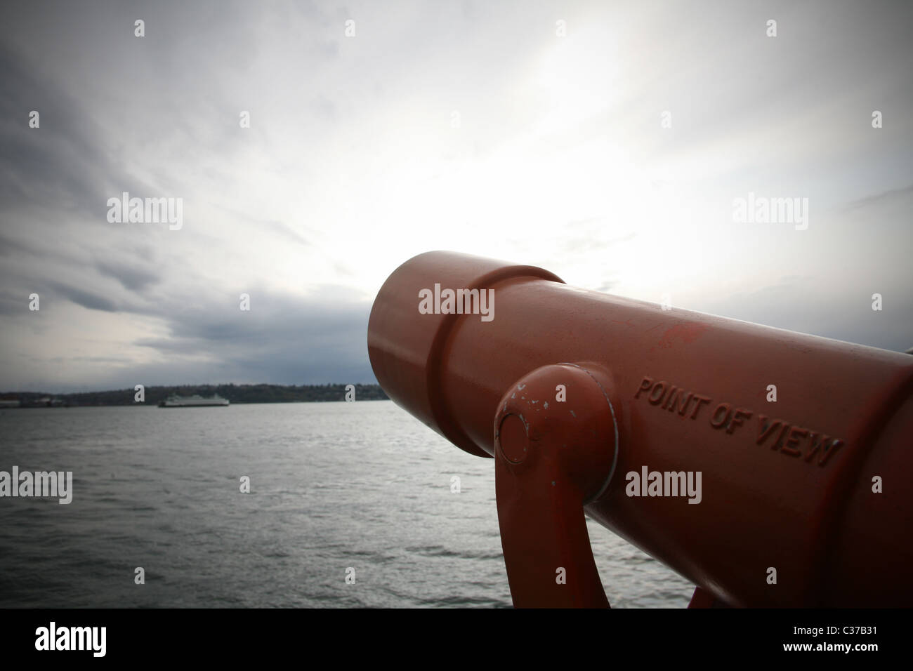Coin-Operated Binoculars (telescope) with cloudy sky. - Stock Image