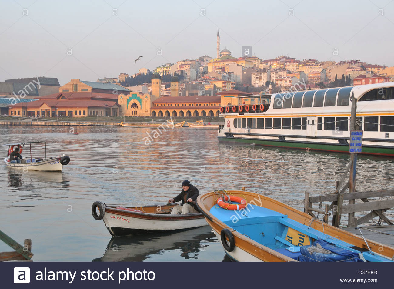 A boatman rowing across the Golden Horn near Eyüp. Such boatmen are still ferrying people across the Golden - Stock Image