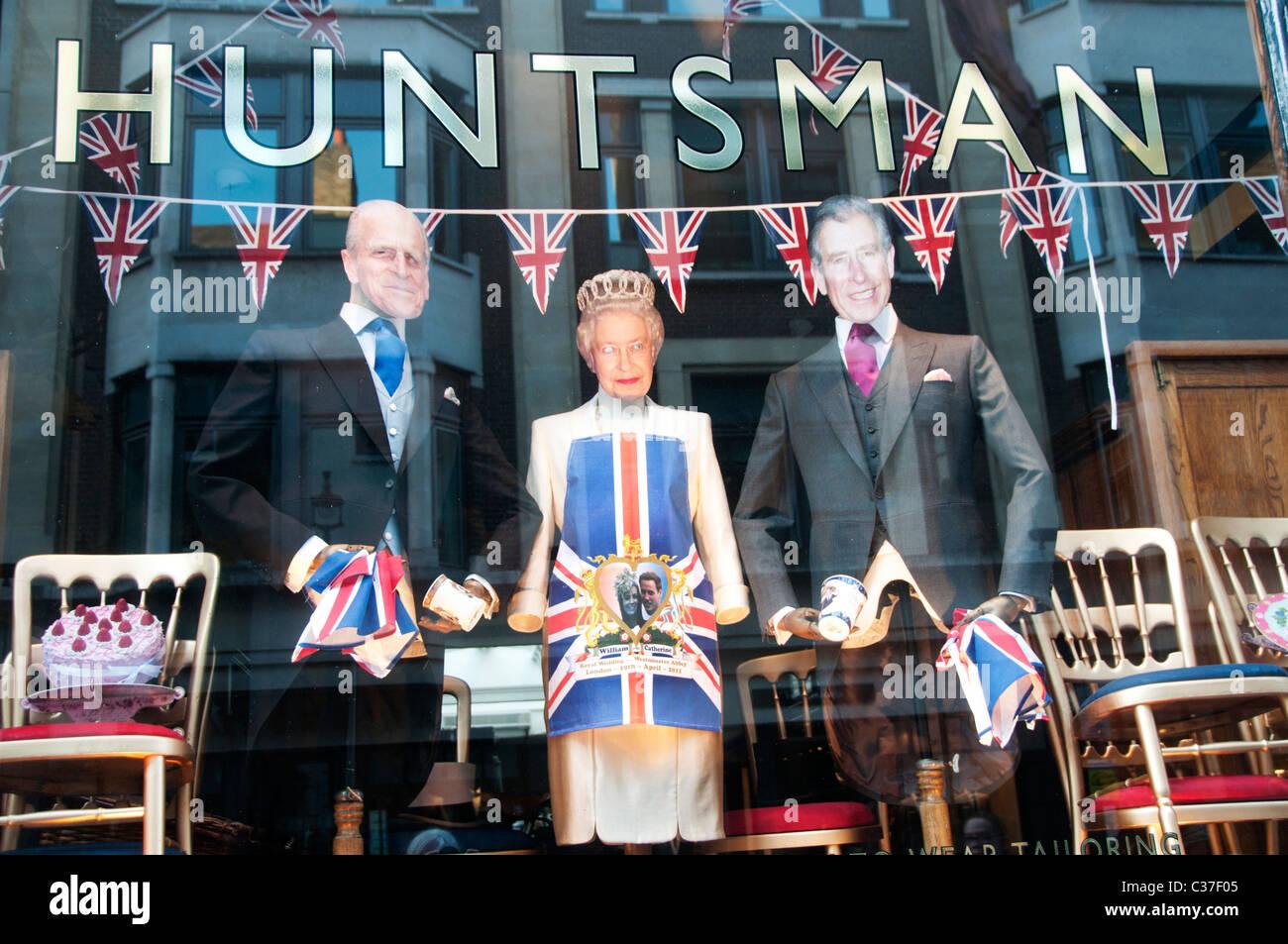London April 2011. Royal Wedding commemoration. Saville Row window display. Royal Family cut out figures. - Stock Image