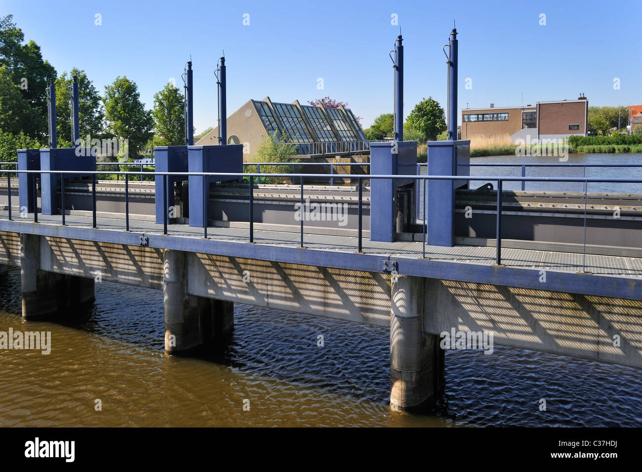 Sluice gates near Archimedean pumping station driven by diesel engines used to drain the polders at Kinderdijk in - Stock Image