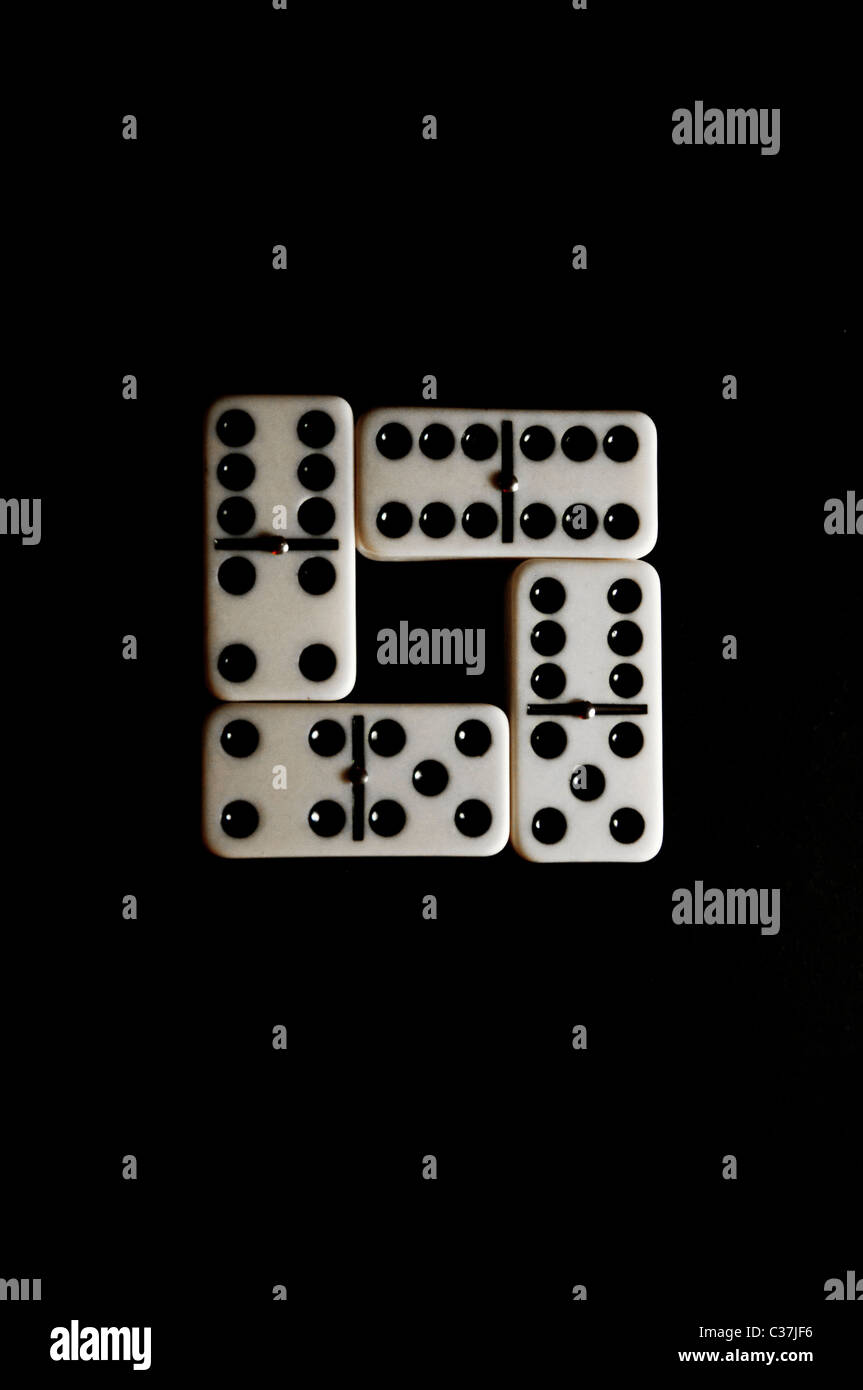 a domino refusing to conform - Stock Image
