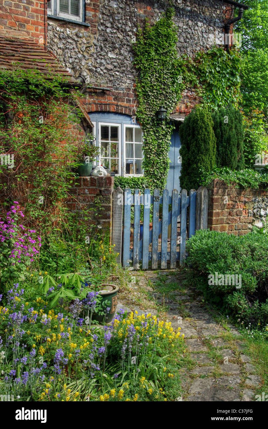 A colourful courtyard garden in the village of West  Wycombe, Buckinghamshire, UK - Stock Image
