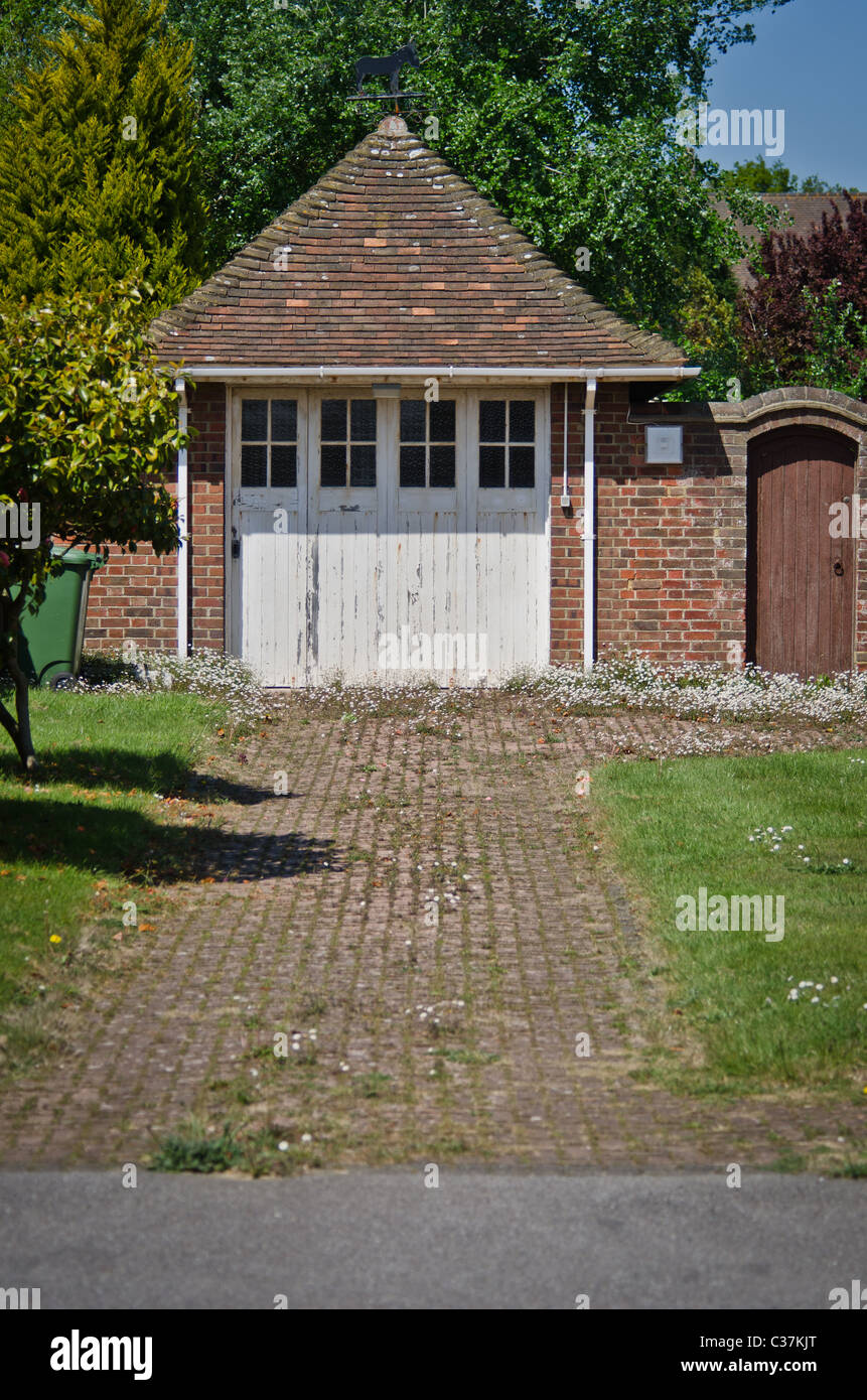 Tiled roof garage of thirties house - Stock Image