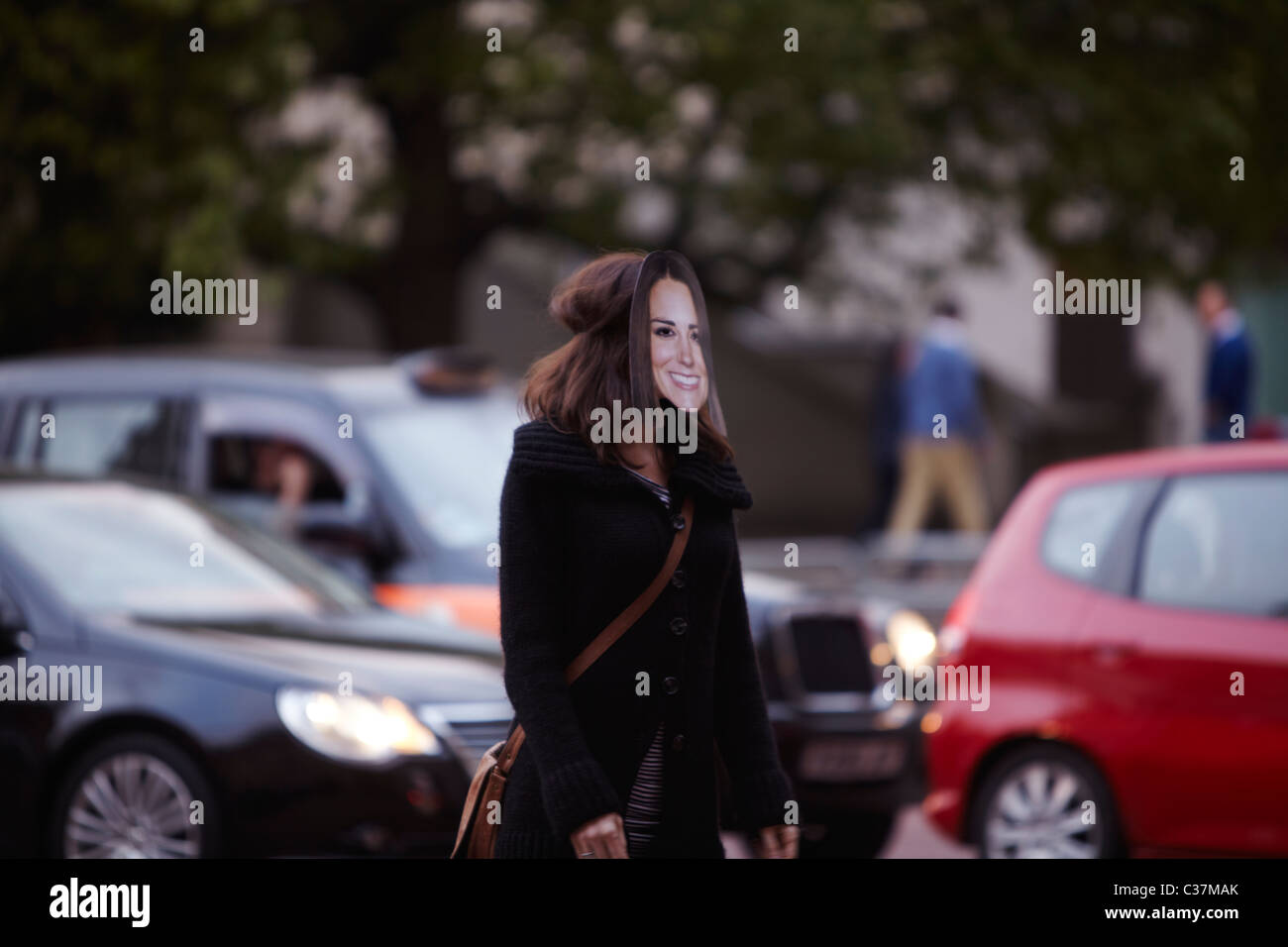 Woman waving wearing a Kate Middleton mask on the mall Stock Photo