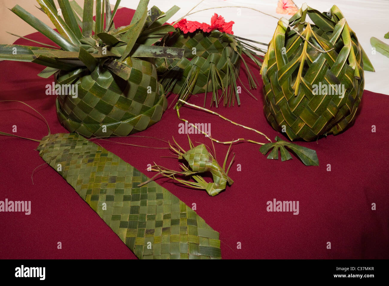 Gifts of a hat,basket,tie and jewelery woven from palm leaves - Stock Image